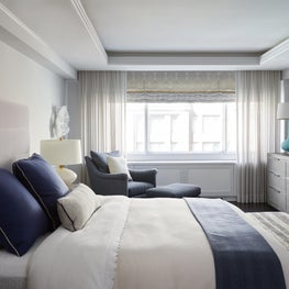 Upper East Side Master Bedroom with gray and navy tone on tone