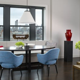 Dining area in a penthouse apartment with dramatic views