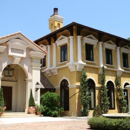 Grand Italian Villa- 20,000 sf. Entry car court, view of 2-story library