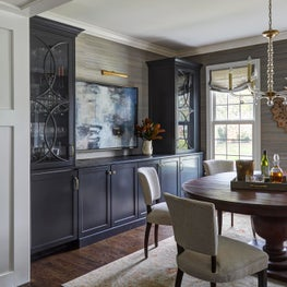 A Sophisticated Dining Room with built-in storage provides a layered design for hosting large or small gatherings.