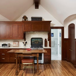 The kitchen with a rich wood stain to tie into the tudor aesthetic