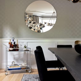Chic dining room with round mirror
