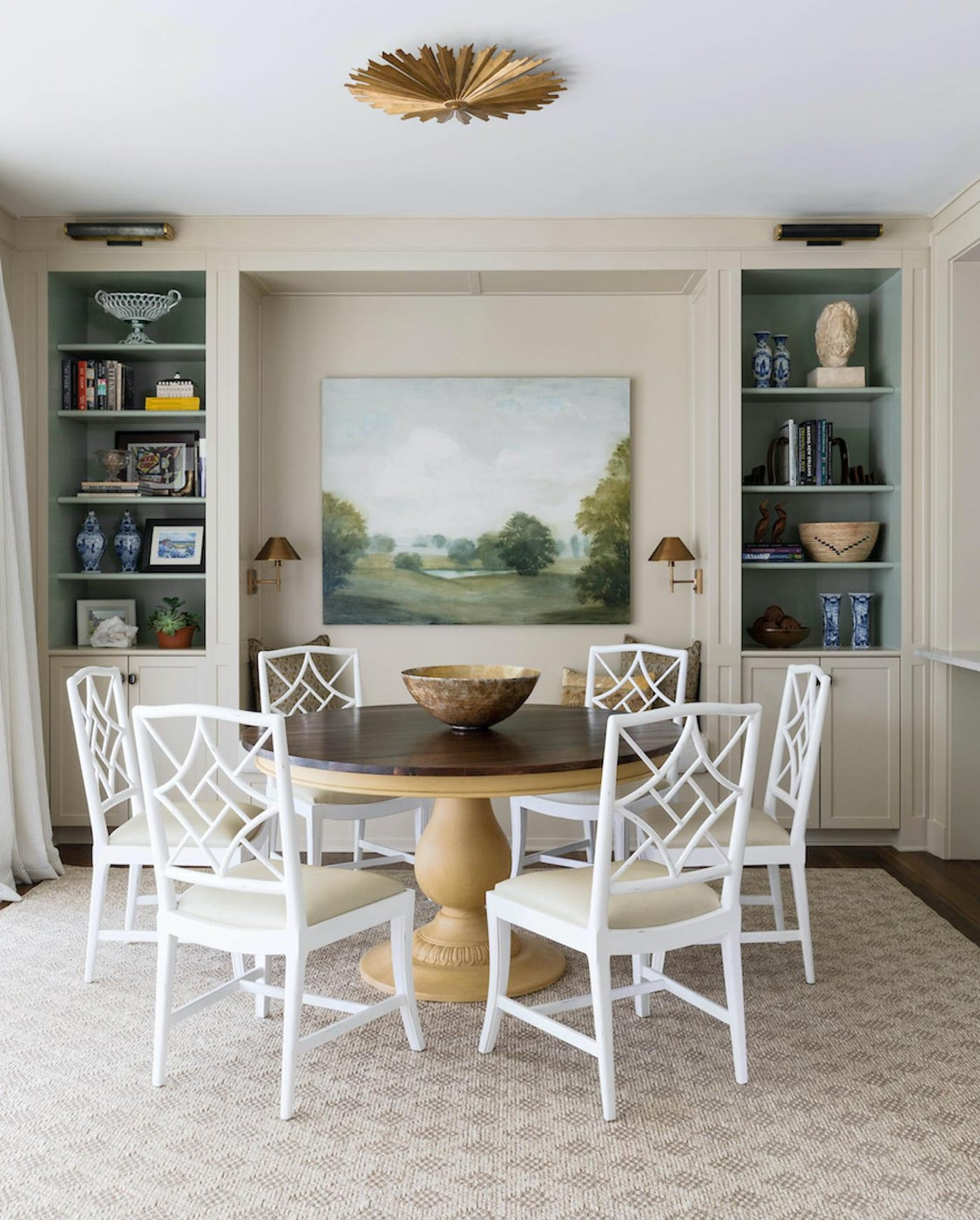 Elegant breakfast nook showcases art and collections