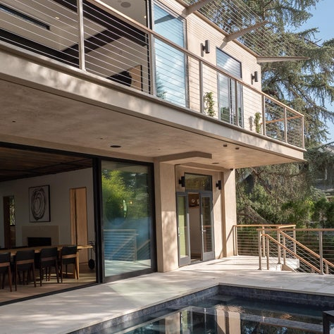 A Modern Glass House Integrated intomIts Surroundings