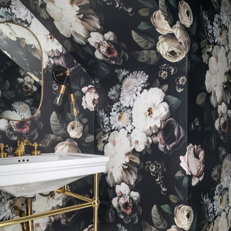 A Floral Wallpapered Powder Bath with Half-Hex Tiles