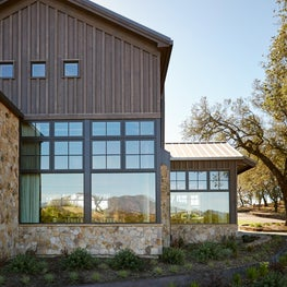 Rustic  Estate detailed with stone and cedar and large custom picture windows.