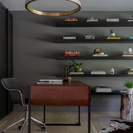 Modern rustic home office with gold ring light, open shelving