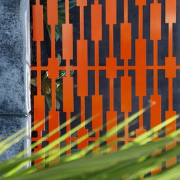 Custom metal garden privacy panel in orange powder-coat