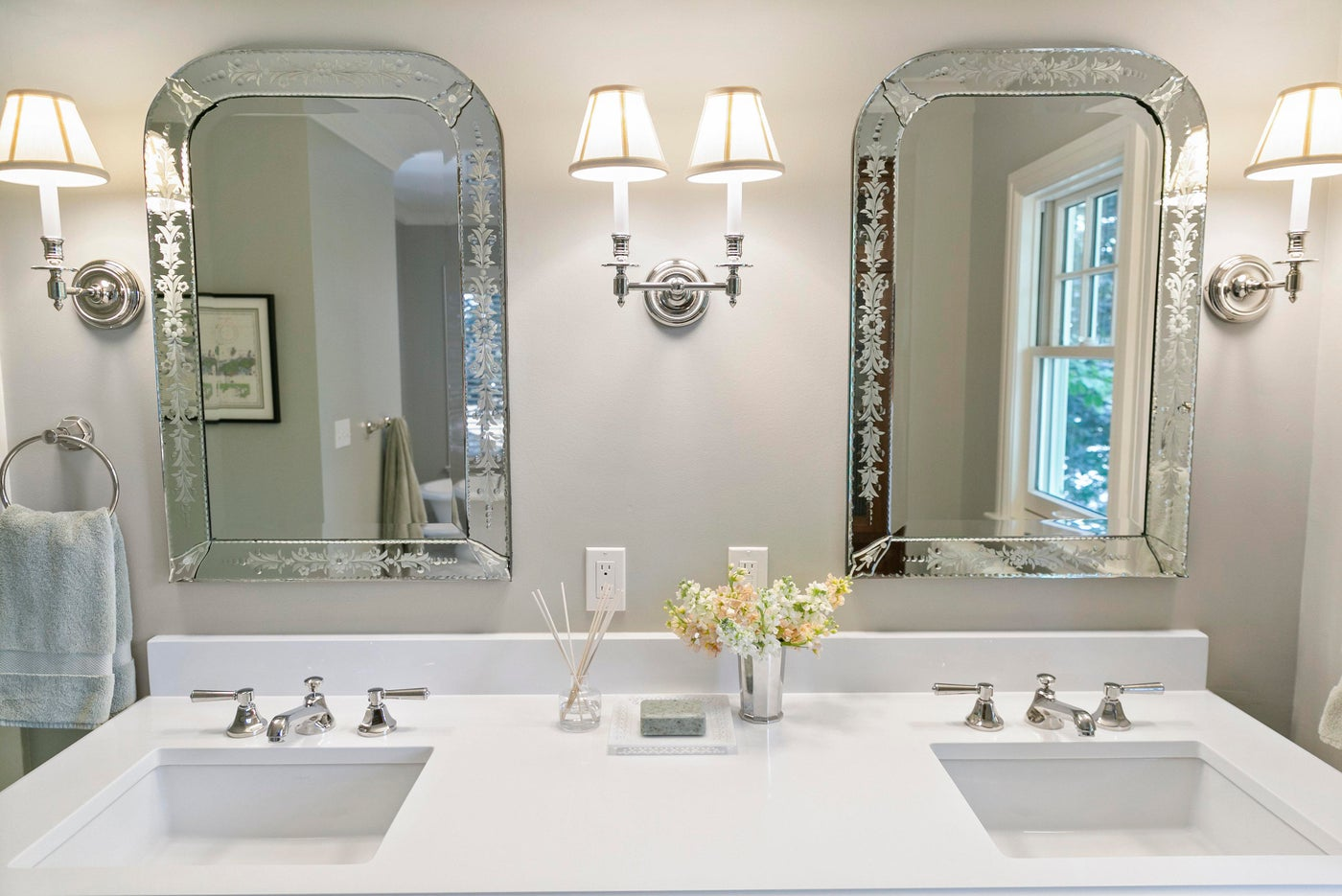 North End Boise master bathroom with white countertops, etched mirrors