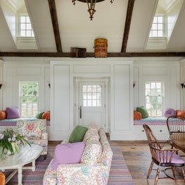 Cape Cod Vacation House in Chatham, Living and dining room with window seat nook