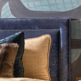 Color and texture mixture of blues and browns in velvet, wall covering, and fur
