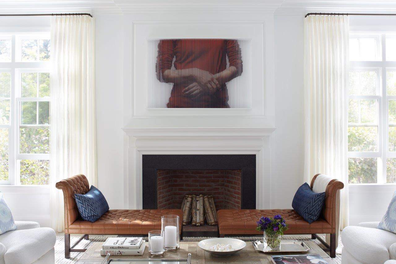 An elegant georgian inspired fireplace and new windows to brigten this room