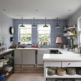 Blue and white kitchen with open storage