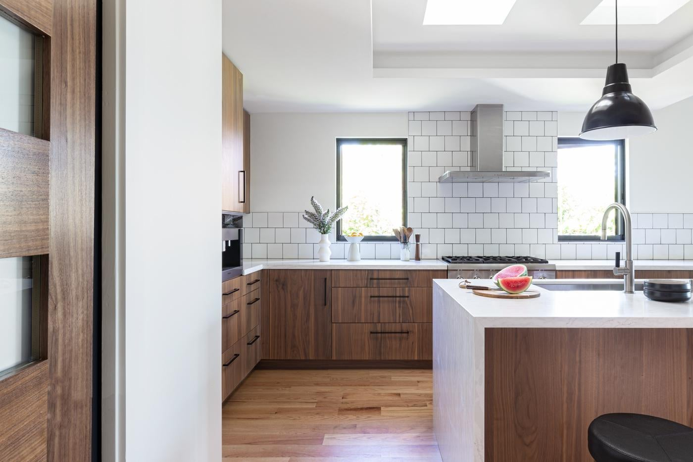 Contemporary Kitchen with Walnut Cabinetry and Quartz Countertops