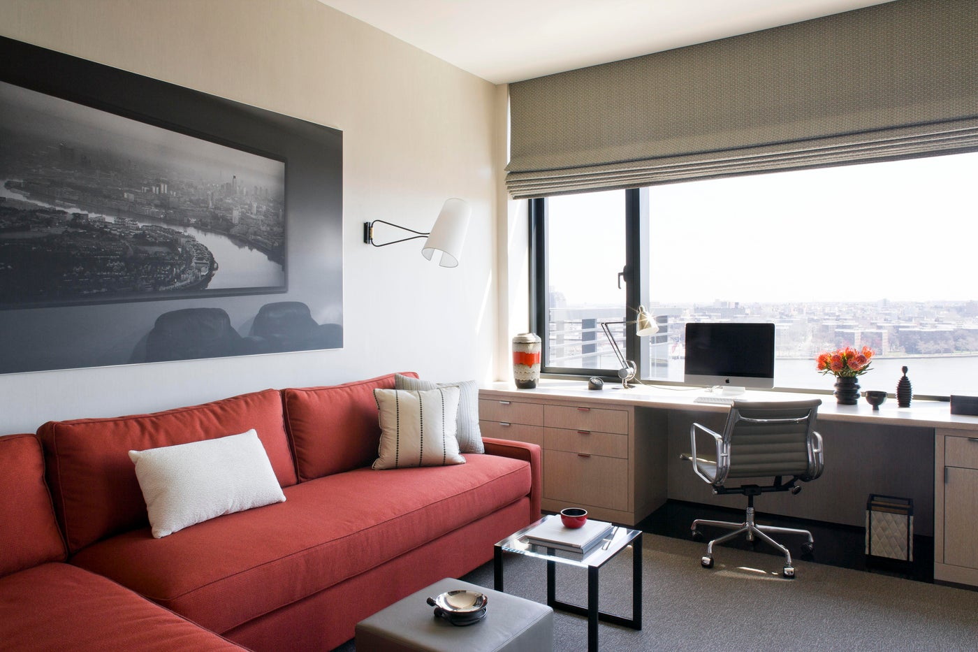 Study in NYC apartment, built in desk, black and white artwork, orange accents