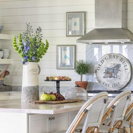 Texas farmhouse kitchen with shiplap walls & woven rattan counter stools