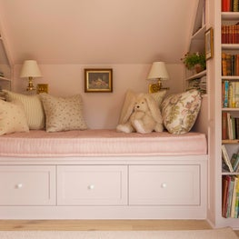 Guest Bedroom and study in a coastal home features a reading nook and built ins.