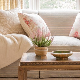 Living Room in a coastal home with neutral patterns and natural textures