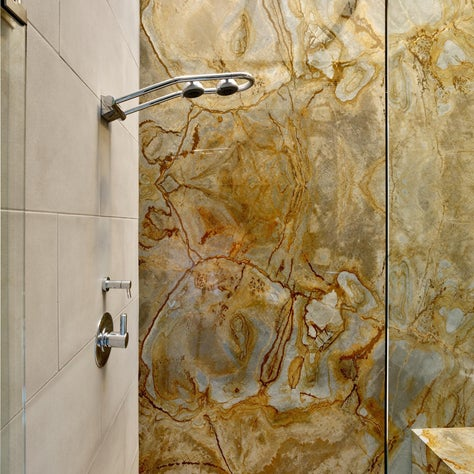 Master shower with slab granite feature wall, autumn colors