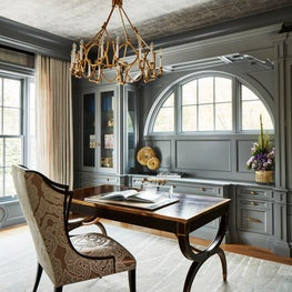 This timeless home office features silver leaf ceilings, custom cabinets.