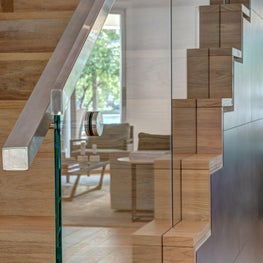 Wooden staircase creates a warm ambiance in this modern home.