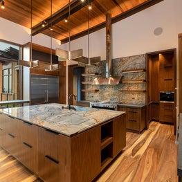 Rays of Light - walnut cabinetry and open shelving, blue quartzite countertop, walnut plank flooring, bronze pendants