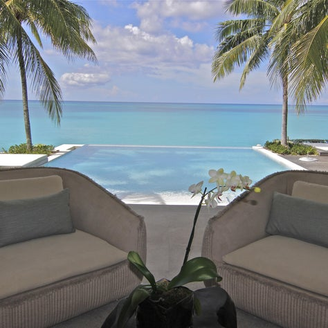 Oversized  lounge seating poolside at our Old Fort Bay project