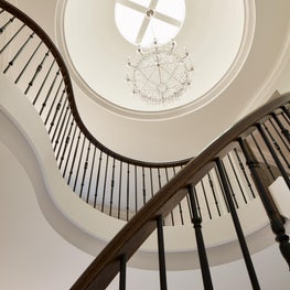 Stunning curved staircase, dome skylight, crystal chandelier, metal ballusters
