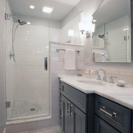 Guest bath completely renovated with custom cabinetry marble and ceramic tile