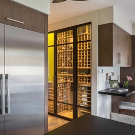 Built-in Wine Room with walnut racks and desk area with magnetic wallpaper to hold all your notes, cards and invitations complete this contemporary Kitchen - Los Altos Hills Residence