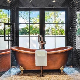 Master bathroom with mosaic floors and copper tub