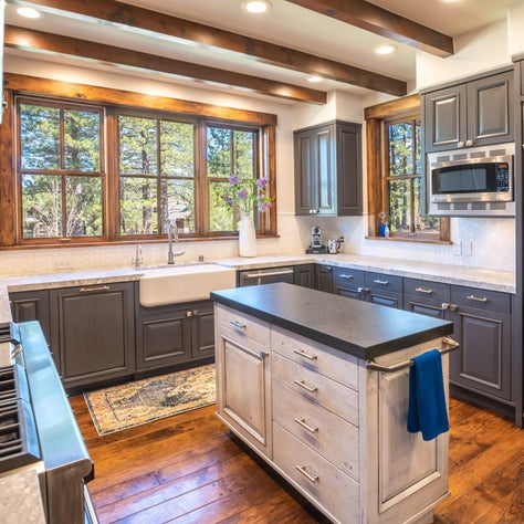 Updated Farmhouse Styled Kitchen with Painted Cabinets and Natural Stone