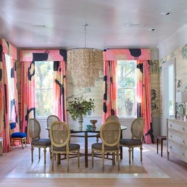 Dining room with antique wallpaper and custom painted silk drapes