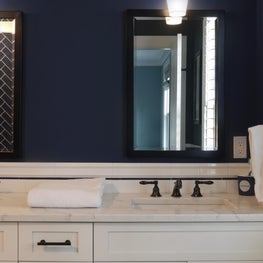 Navy Blue Bath with White Vanity and Black Fixtures