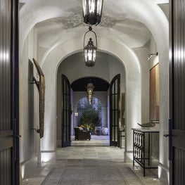 Dramatic entry with a series of groin vaults & antique lanterns; Houston, TX