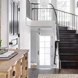 Entry with sweeping staircase at Hillsborough residence.