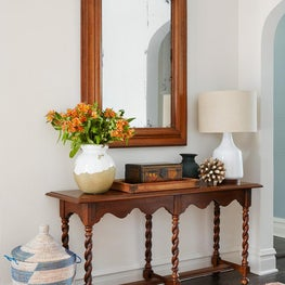 Central Park Foyer with Antique Mirror, Vintage Wood Console and Vintage Rug