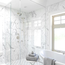 Bath with natural wood and marble finishes