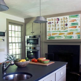 Slate gray countertops juxtapose neutral colored cabinetry in this kitchen.