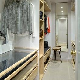 Small condo walk-in closet. White oak and white melamine millwork.