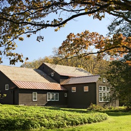 Restoration of a 1796 Connecticut carriage house featuring wood & copper roofs.