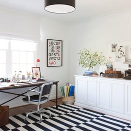 Bright White Office. Black + White + Pop of Red. Striped Rug.