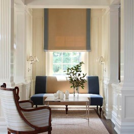 Blue and White Living Room Seating Area with Settee