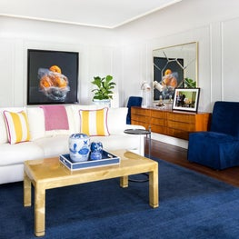 A Living Room in a charming home combines vintage finds with preppy details.