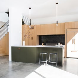 Warm Modern Open Plan with Concrete Floors and Handmade Ceramic Tile