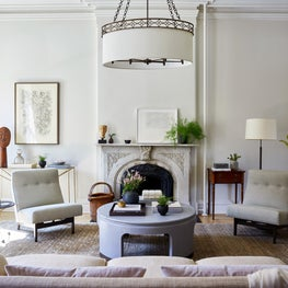 Hudson Street Brownstone I Living Room | Vintage Mix | Marble Fireplace