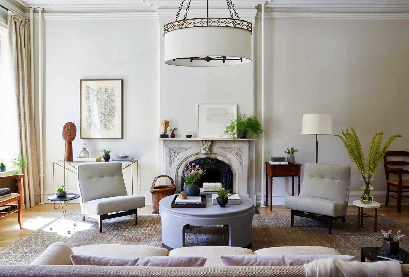 Hudson Street Brownstone I Living Room | Vintage Mix | Marble Fireplace