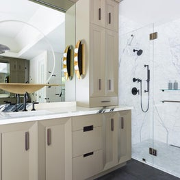 Open and Airy Master Bathroom with Custom Cabinets