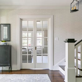 North End Boise entry foyer with metal candle pendant and vintage black cabinet