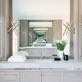Primary bathroom with nickel inset cabinetry and Carrara countertop